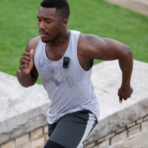 Photo of a man sweating, running up steps.